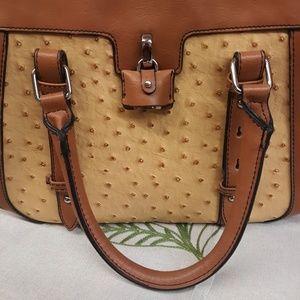 Used.London fog ostrich print satchel